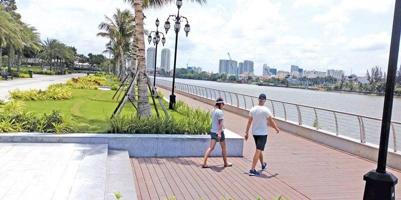 Walking road a long Saigon river